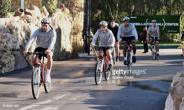Emre Can Roberto Firmino Joel Matip and Ragnar Klavan of Liverpool arrive on a bike before a training session at Marbella Football Center on February...