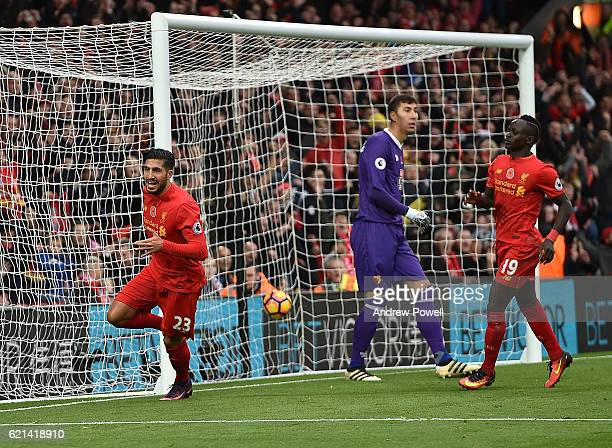 Emre Can scores the third goal and celebrates for Liverpool during the Premier League match between Liverpool and Watford at Anfield on November 6...