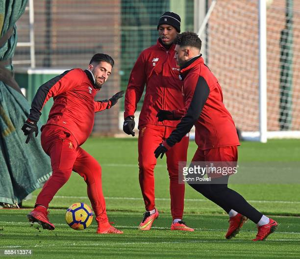Emre Can with Alex OxladeChamberlain and Daniel Sturridge of Liverpool during a training session at Melwood Training Ground on December 8 2017 in...