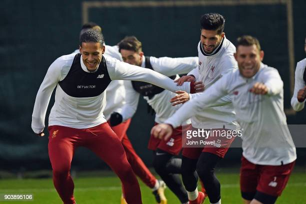 Emre Can with Virgil van Dijk of Liverpool during a training session at Melwood Training Ground on January 11 2018 in Liverpool England