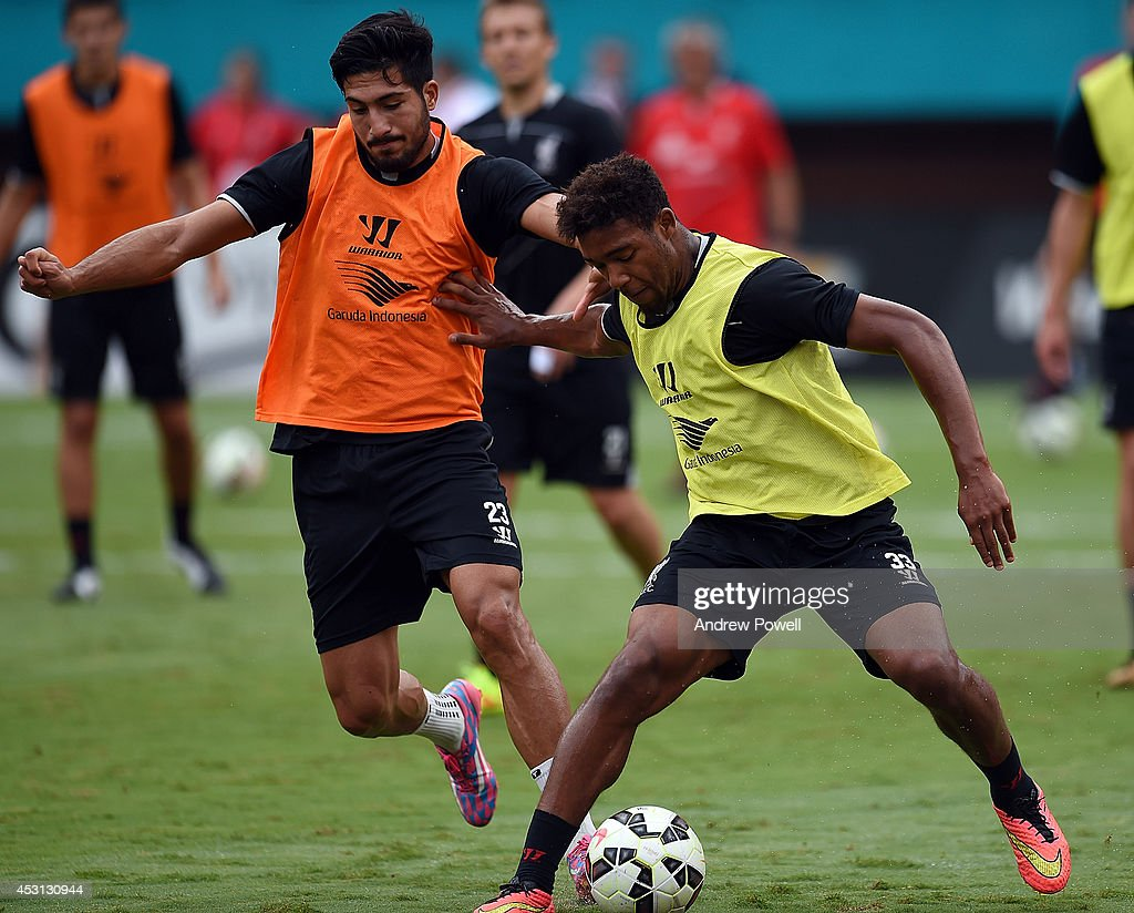 Emre Cana and Jordon Ibe of Liverpool in action during an open training session at Sunlife Stadium on August 3, 2014 in Miami, Florida.