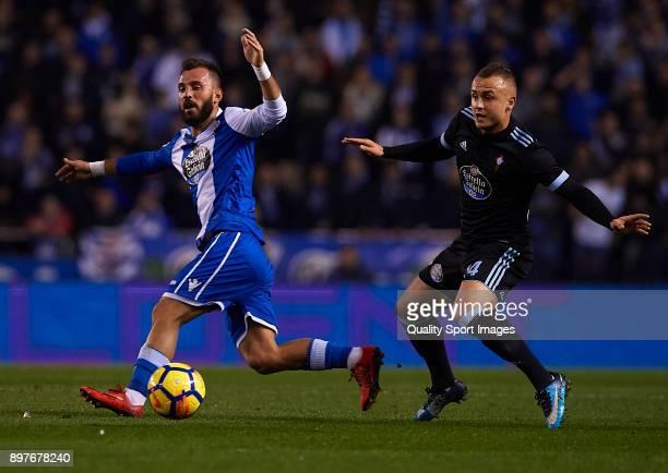 Emre Colak of Deportivo de La Coruna competes for the ball with Lobotka of Celta de Vigo during the La Liga match between Deportivo de La Coruna and...