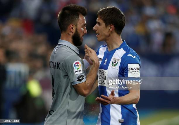 Emre Colak of Deportivo La Coruna argue with Alexander Szymanowski of Leganes during the La Liga football match between Leganes and Deportivo La...