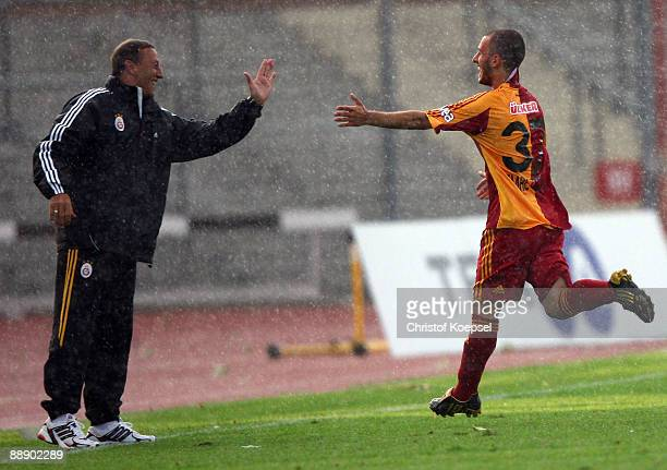 Emre Colak of Galatasaray celebrates the first goal with assistant coach Johann Neeskens during the Zayon Cup match between Galatasaray Istanbuch and...