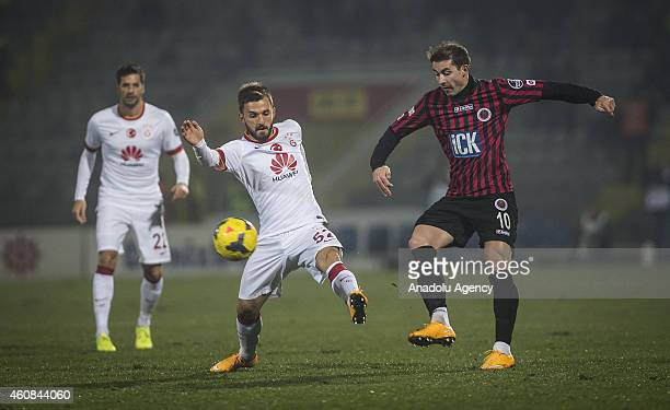 Emre Colak of Galatasaray vies for the ball with Bogdan Stancu of Genclerbirligi during Turkish Spor Toto Super League soccer match between...
