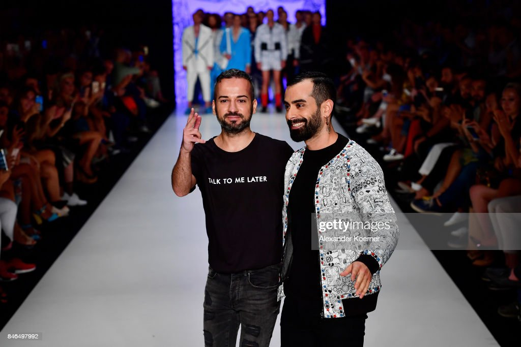 Emre Erdemoglu (L) and Gokhan Turkmen walk the runway at the Emre Erdemoglu show during Mercedes-Benz Istanbul Fashion Week September 2017 at Zorlu Center on September 13, 2017 in Istanbul, Turkey.