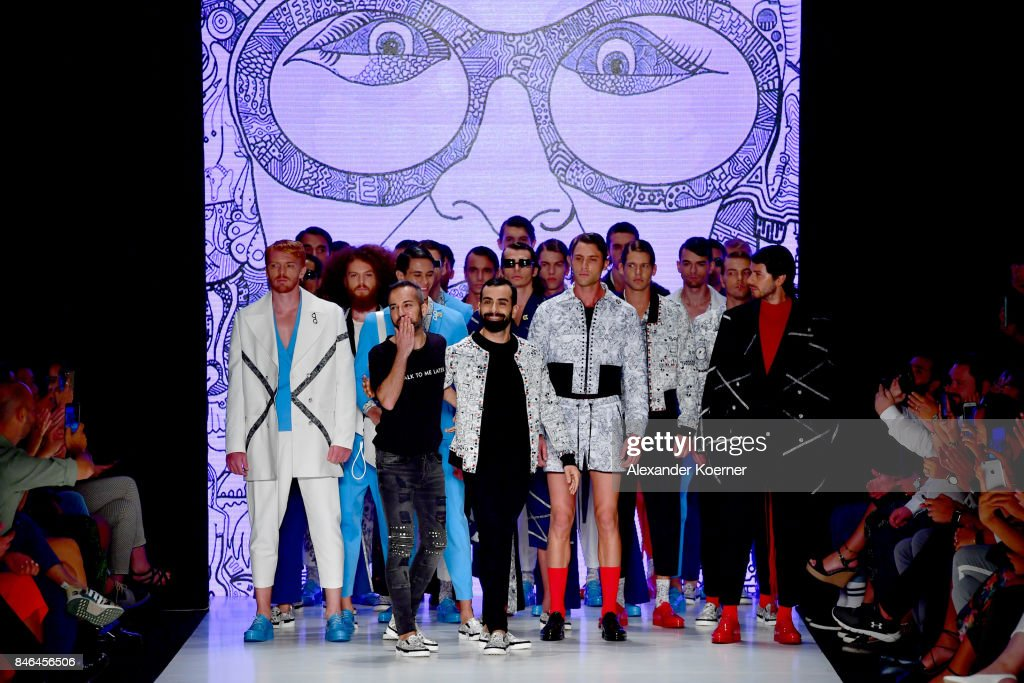 Emre Erdemoglu and Gokhan Turkmen walk the runway with the models at the Emre Erdemoglu show during Mercedes-Benz Istanbul Fashion Week September 2017 at Zorlu Center on September 13, 2017 in Istanbul, Turkey.