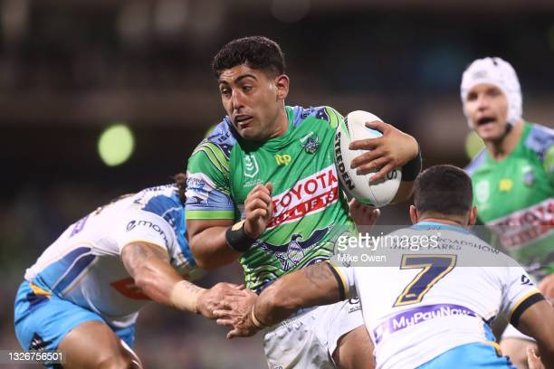Emre Guler of the Raiders is tackled during the round 16 NRL match between the Canberra Raiders and the Gold Coast Titans at GIO Stadium, on July 03...