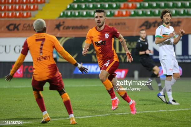 Emre Kilinc of Galatasaray and his teammates celebrate after scoring a goal during the Turkish Super Lig match between Aytemiz Alanyaspor and...