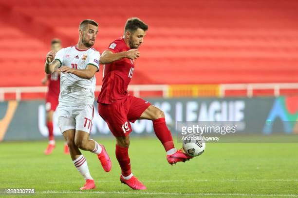 Emre Kilinc of Turkey national football team in action against Filip Holender of Hungary national football team during the UEFA Nations League B -...