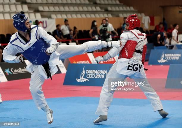 Emre Kutalmis Atesli of Turkey in action against Mohamed Abdelmawgood of Egypt during the Taekwondo Men's 80 kg match within the XVIII Mediterranean...