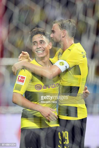 Emre Mor of Borussia Dortmund celebrates the second goal with Marcel Schmelzer during the preseason friendly match between Urawa Red Diamonds and...