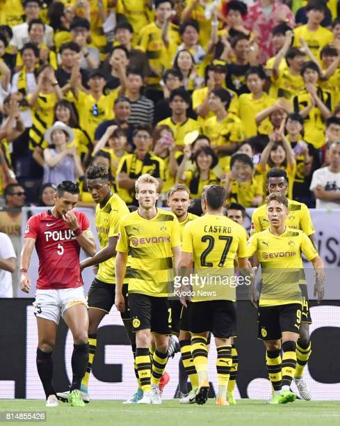 Emre Mor of Borussia Dortmund celebrates with his teammates after scoring his second goal during the second half of an international friendly against...