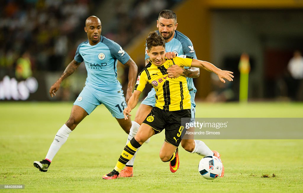 Emre Mor of Borussia Dortmund in action against Aleksander Kolarov of Manchester City during the International Champions Cup China match between Manchester City and Borussia Dortmund during Borussia Dortmund's Summer Asia Tour 2016 on July 28 2016 in Shenzhen, China.