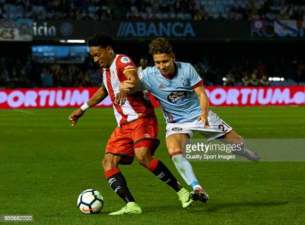 Emre Mor of Celta de Vigo competes for the ball with Johan Andres Mojica of Girona FC during the La Liga match between Celta de Vigo and Girona at...