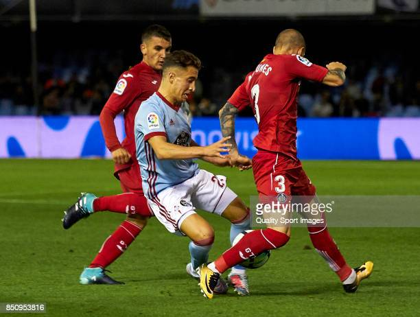 Emre Mor of Celta de Vigo competes for the ball with Vitorino Antunes of Getafe CF during the La Liga match between Celta de Vigo and Getafe CF at...