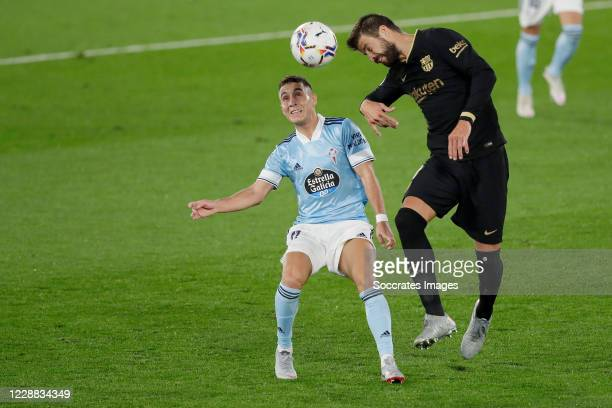 Emre Mor of Celta de Vigo Gerard Pique of FC Barcelona during the La Liga Santander match between Celta de Vigo v FC Barcelona at the Estadio de...