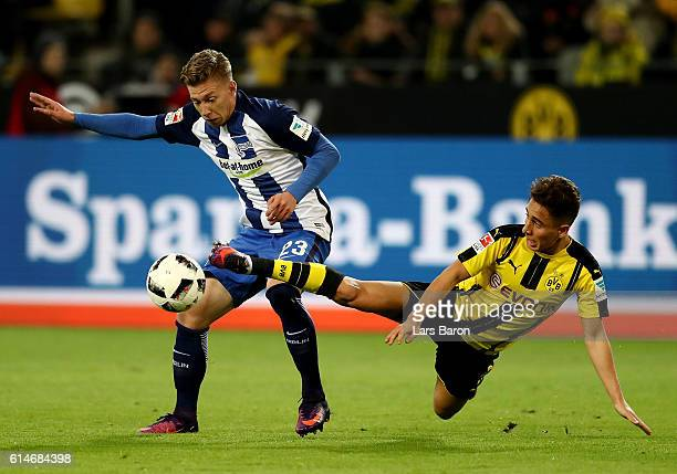 Emre Mor of Dortmund and Mitchell Weiser of Berlin battle for the ball during the Bundesliga match between Borussia Dortmund and Hertha BSC at Signal...