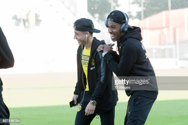 Emre Mor of Dortmund and PierreEmerick Aubameyang of Dortmund looks on during a friendly match between Espanyol Barcelona and Borussia Dortmund as...