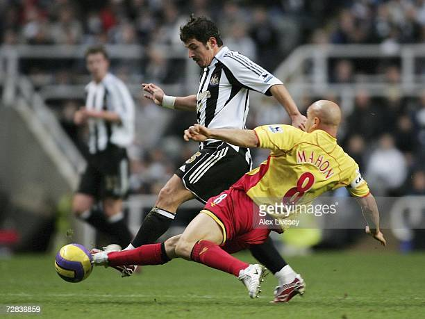 Emre of Newcastle United is tackled by Gavin Mahon of Watford during the Barclays Premiership match between Newcastle United and Watford at St James'...