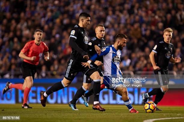 Emre Çolak of Deportivo de La Coruna is challenged by Pablo 'Tucu' Hernandez of Celta de Vigo during the La Liga match between Deportivo La Coruna...