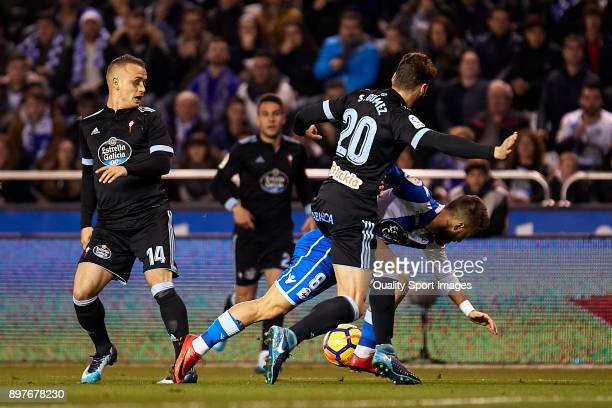 Emre Çolak of Deportivo de La Coruna is challenged by Sergi Gomez of Celta de Vigo during the La Liga match between Deportivo La Coruna and Celta de...
