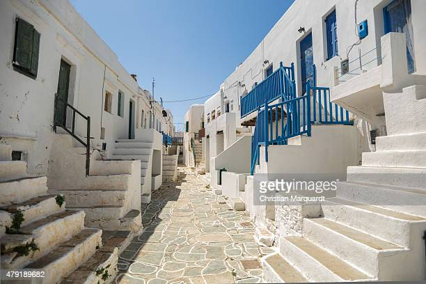 A emtpy backstreet with white washed buildings during midday sun in the town of Ano Meria on June 13 2015 in Folegandros Greece Folegandros is a...