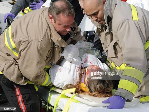 EMTs Lower Patient Onto A Stretcher