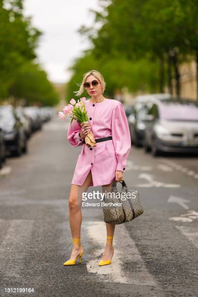 Emy Venturini @sustainably_by_emy , stylist, wears sunglasses from Komono, a pale pink vintage dress from Krizia, a Hermes belt, a brown monogram...