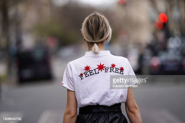 "Emy Venturini @sustainably_by_emy wears a white turtleneck t-shirt from Ipsilon Paris with printed red stars and the slogan ""Feel Free"", black..."