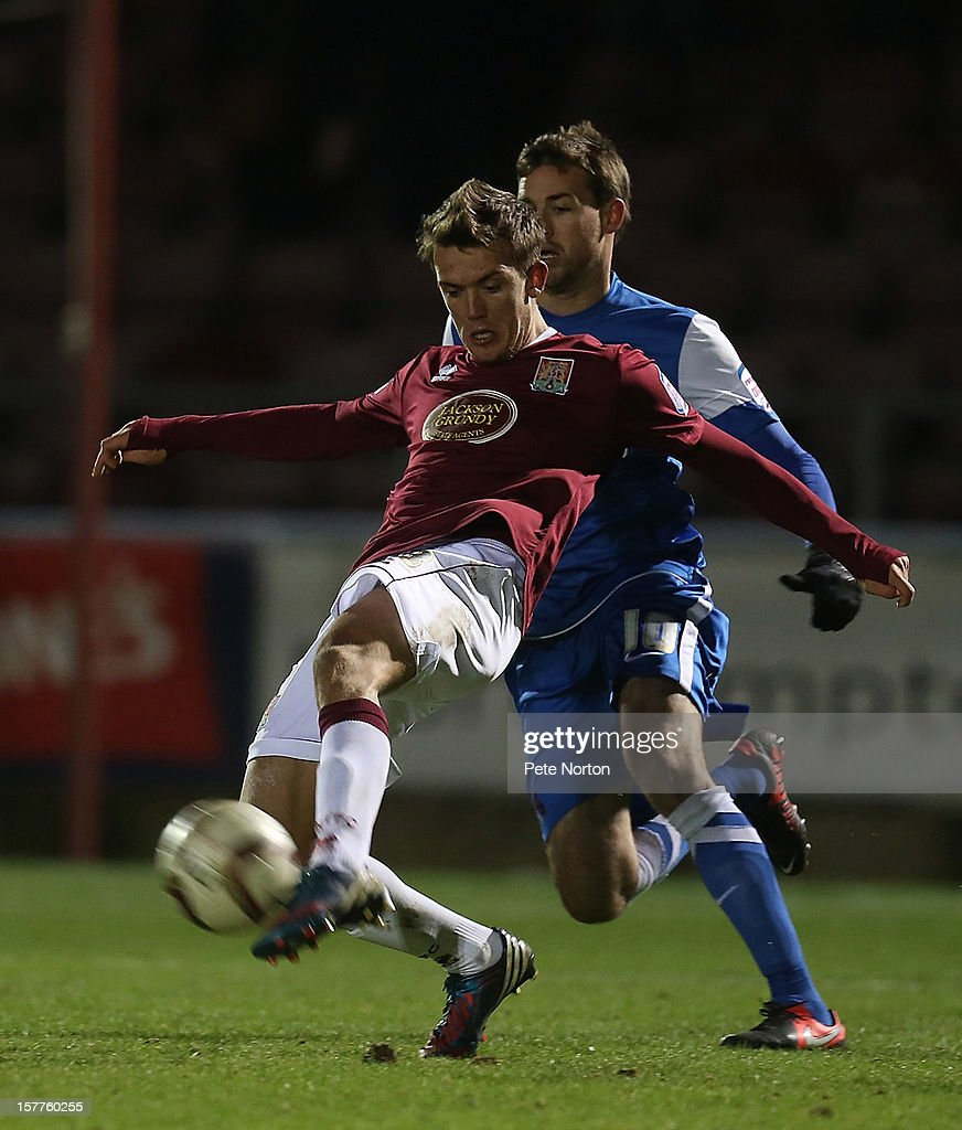Emyr Huws of Northampton Town clears the ball from Michael Symes of Leyton Orient during the Johnstone's Paint Trophy Quarter Final match between Northampton Town and Leyton Orient at Sixfields Stadium on December 5, 2012 in Northampton, England.
