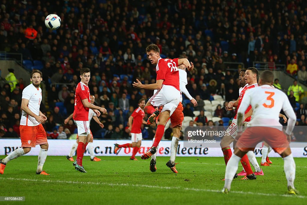 Emyr Huws of Wales heads his sides second goal during the international friendly match between Wales and Netherlands at Cardiff City Stadium on November 13, 2015 in Cardiff, Wales.