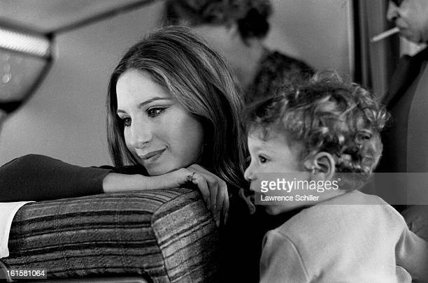 En route to London American actress and singer Barbra Streisand poses for her son Jason Gould 1969