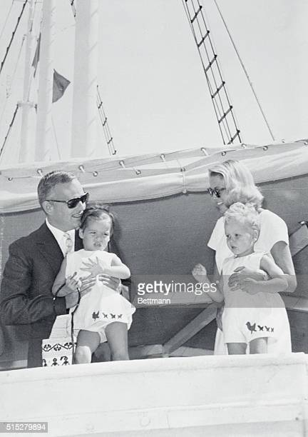 En route to the Olympics Naples Italy Prince Rainier of Monaco holds his daughter Caroline and wife Princess Grace holds their son Albert as they...