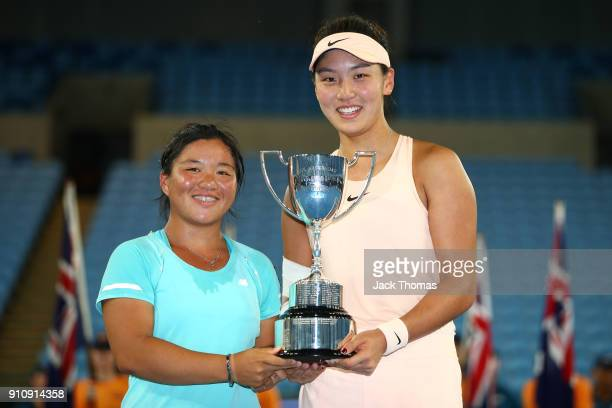 En Shuo Liang of Taipei and Xinyu Wang of China pose for a photo with the championship trophy after winning the Junior Girls' Doubles Final at the...