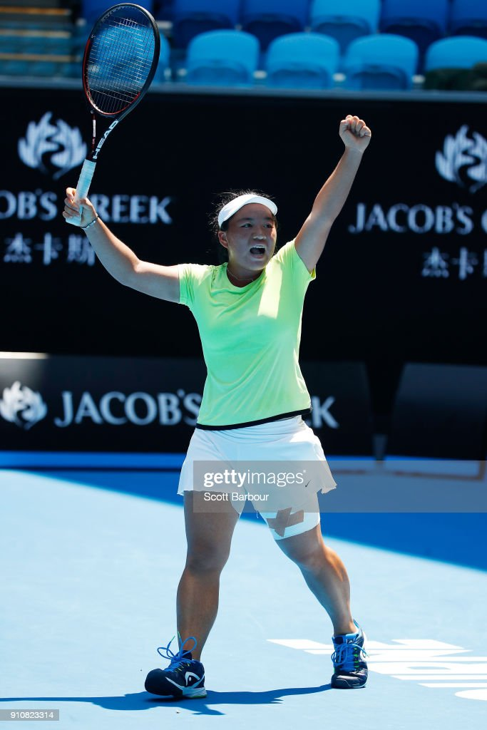 En Shuo Liang of Taipei celebrates winning match point in the Junior Girls' Singles Final against Clara Burel of France during at the Australian Open 2018 Junior Championships at Melbourne Park on January 27, 2018 in Melbourne, Australia.