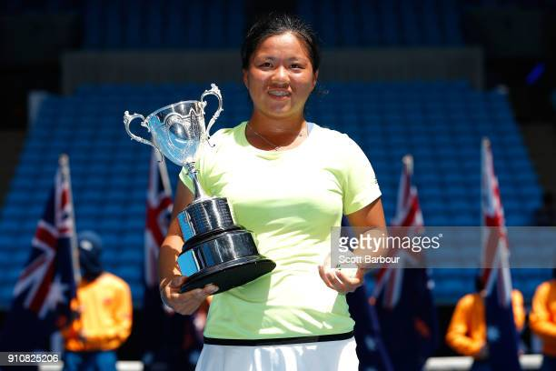 En Shuo Liang of Taipei poses with the championship trophy after winning the Junior Girls' Singles Final against Clara Burel of France at the...