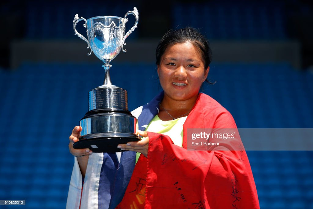 En Shuo Liang of Taipei poses with the championship trophy after winning the Junior Girls' Singles Final against Clara Burel of France at the Australian Open 2018 Junior Championships at Melbourne Park on January 27, 2018 in Melbourne, Australia.