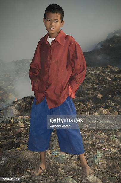 En Vibol 13 years old goes to school three mornings a week the rest of the time he works at the dump He would like to be an English teacher He found...