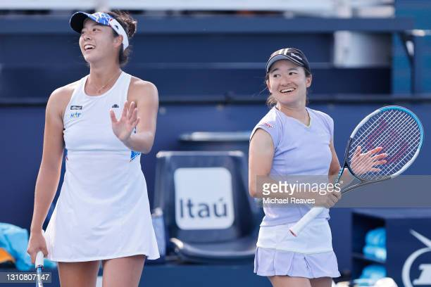 Ena Shibahara and Shuko Aoyama of Japan celebrate match point after defeating Hayley Carter of the United States and Luisa Stefani of Brazil during...