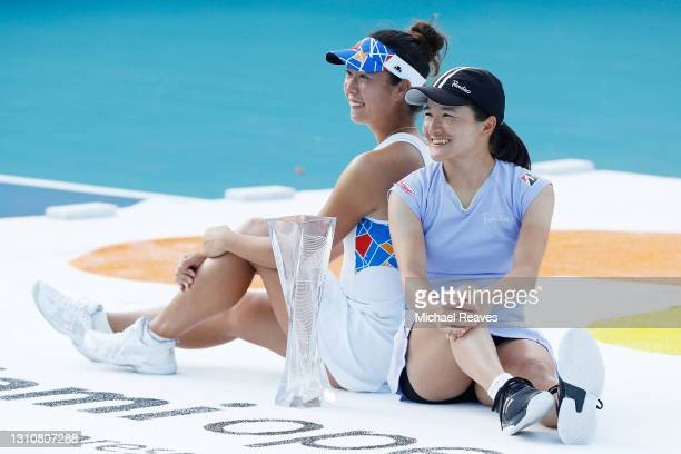 Ena Shibahara and Shuko Aoyama of Japan pose with the winner's trophy after defeating Hayley Carter of the United States and Luisa Stefani of Brazil...
