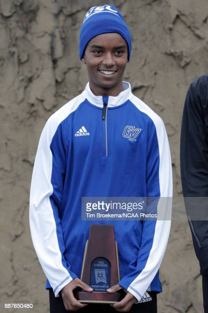 Enael Woldemichael is photographed with his sixth place trophy with Elias Gedyon of Adams State University during the Division II Men's Cross Country...