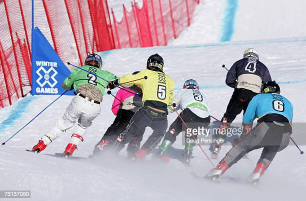 Enak Gavaggio in black leads Daron Rahlves of Sugarbowl California in white as the pack gets crowded pushing Chris Del Bosco in green off course and...