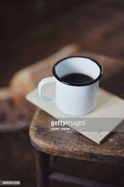 Enamel coffee cup on wooden chair