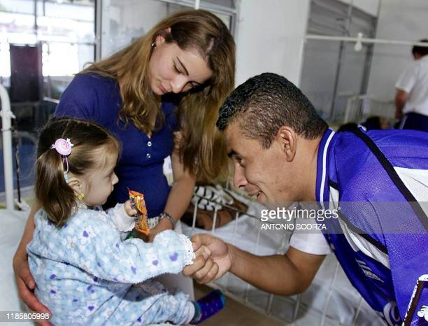 Enamorado , a soccer player from Honduras, greets a sick girl on July 25 2001 during a visit to a Red Cross Hospital for children in Manizales,...