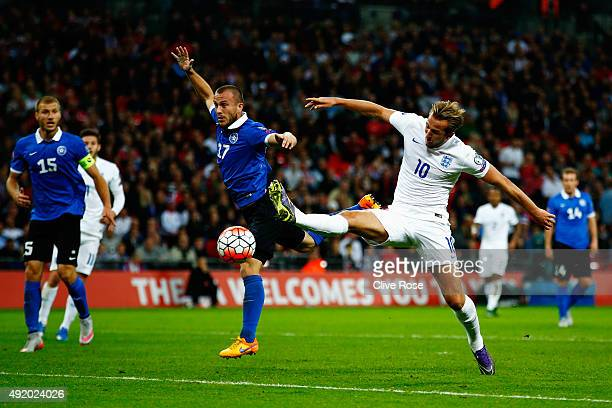 Enar Jaager of Estonia and Harry Kane of England challenge for the ball during the UEFA EURO 2016 Group E qualifying match between England and...