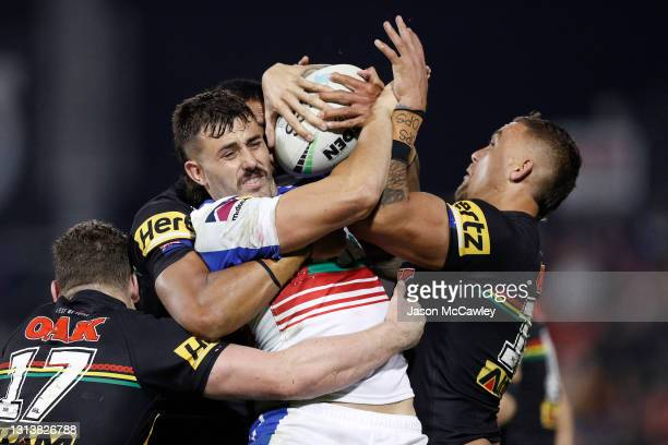 Enari Tuala of the Knights is tackled during the round seven NRL match between the Penrith Panthers and the Newcastle Knights at BlueBet Stadium, on...