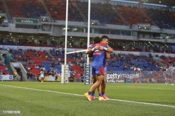 Enari Tuala of the Newcastle Knights celebrates a try with a team mate during the round 19 NRL match between the Newcastle Knights and the St George...