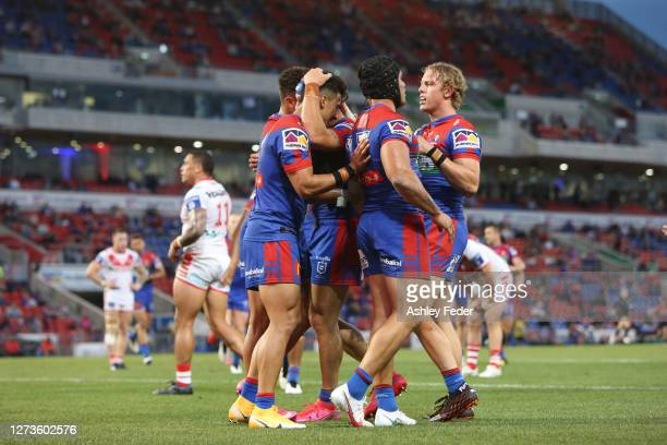 Enari Tuala of the Newcastle Knights celebrates with team mates during the round 19 NRL match between the Newcastle Knights and the St George...