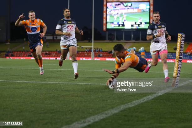 Enari Tuala of the Newcastle Knights scores a try during the round 15 NRL match between the Newcastle Knights and the North Queensland Cowboys at...